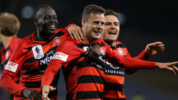 Wanderers players celebrate Oriol Riera's last minute winner against the Phoenix.