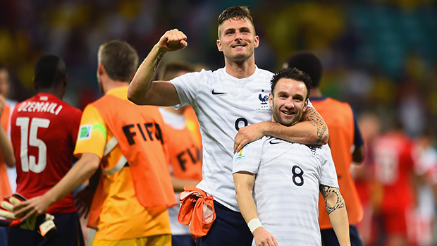 Olivier Giroud and Mathieu Valbuena of France celebrate after defeating Switzerland.