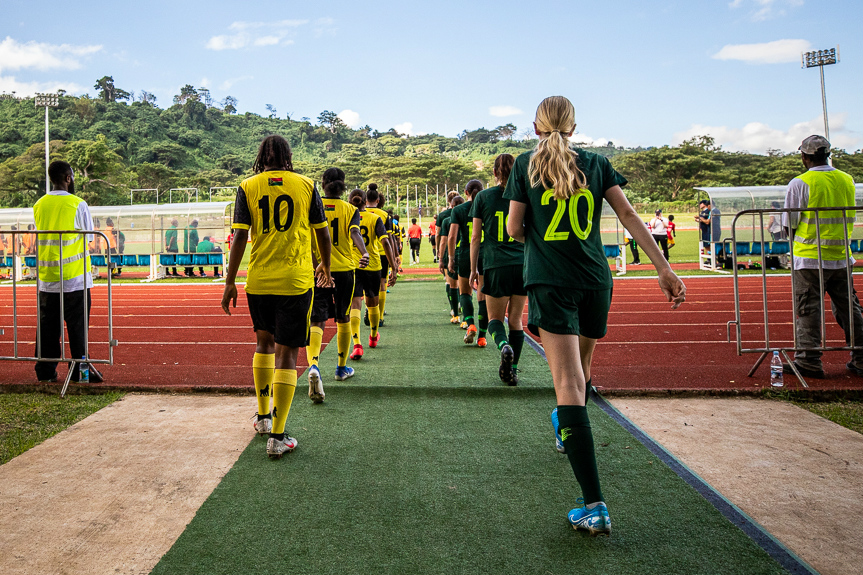 The Westfield Junior Matildas and Vanuatu walk out for their clash last month (Pic by Joseph Mayers)
