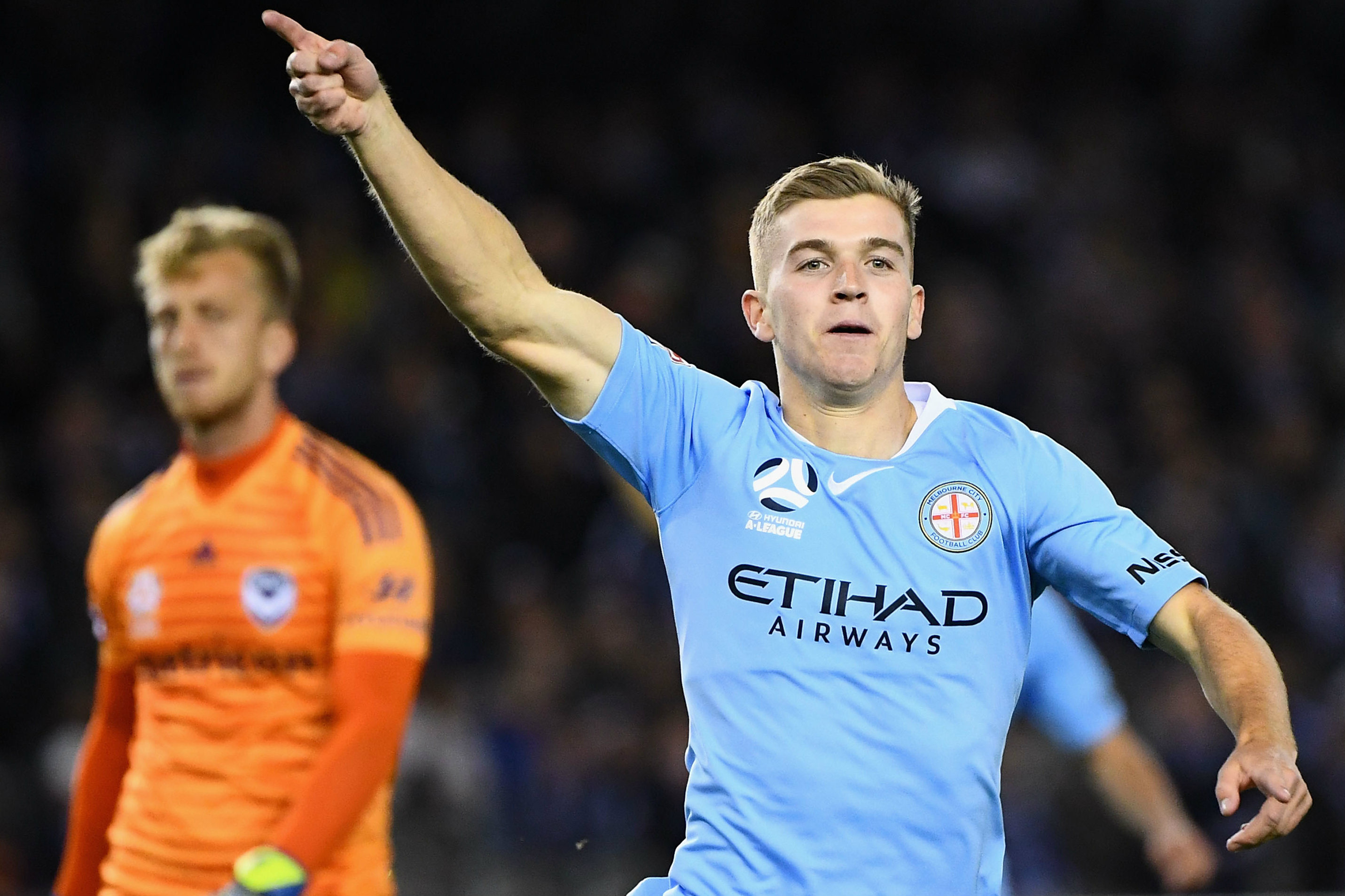 Reds midfielder Riley McGree celebrating a goal while playing for City last season