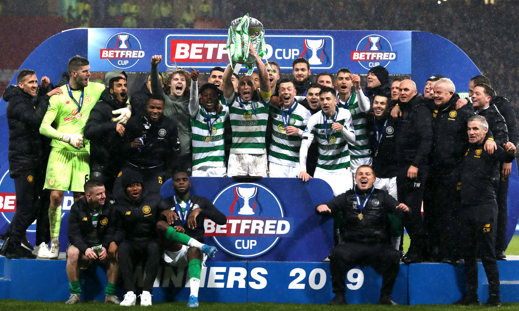 Rogic celebrates with Celtic's victorious League Cup winning squad