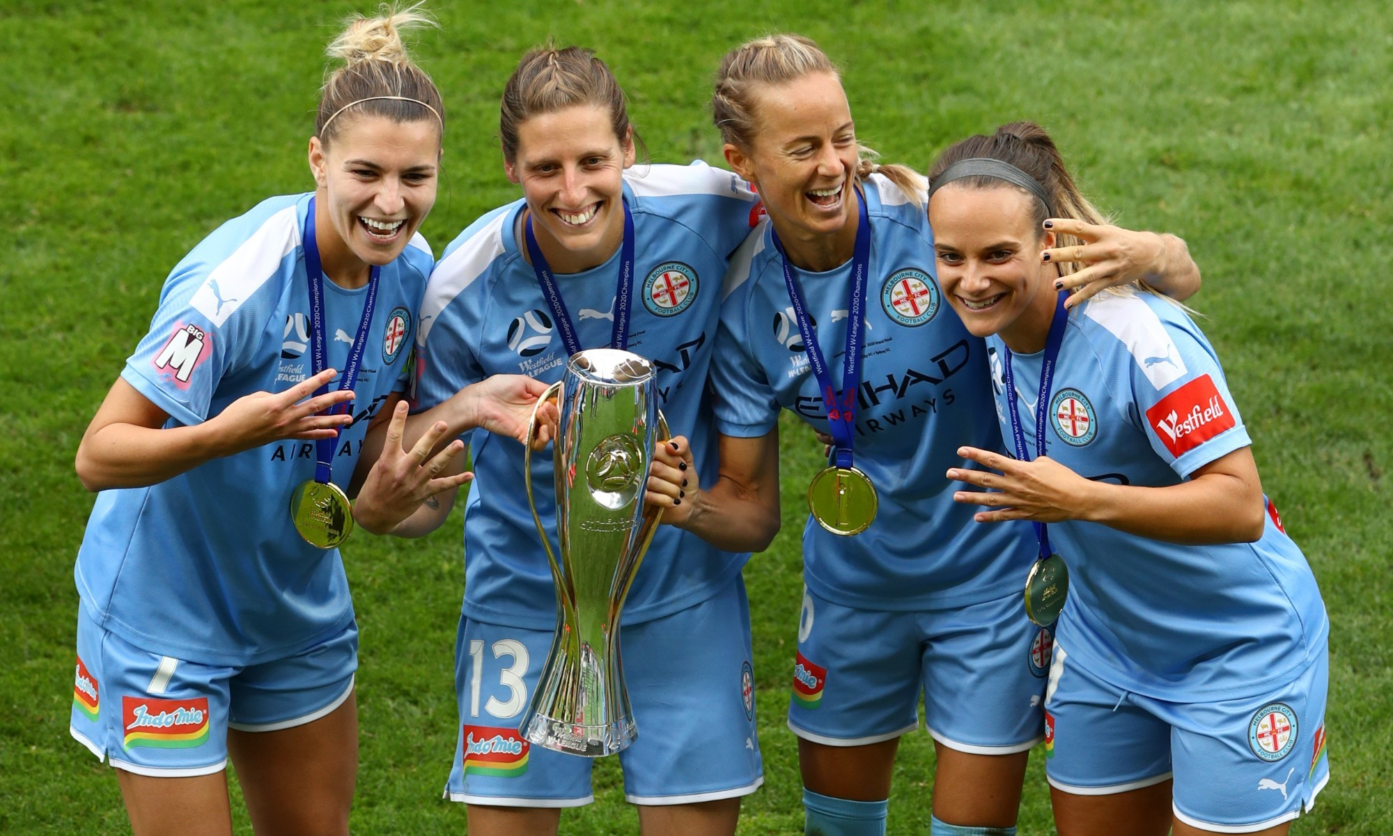 Aivi Luik celebrates with Steph Catley, Rebekah Stott and Ellie Carpenter.