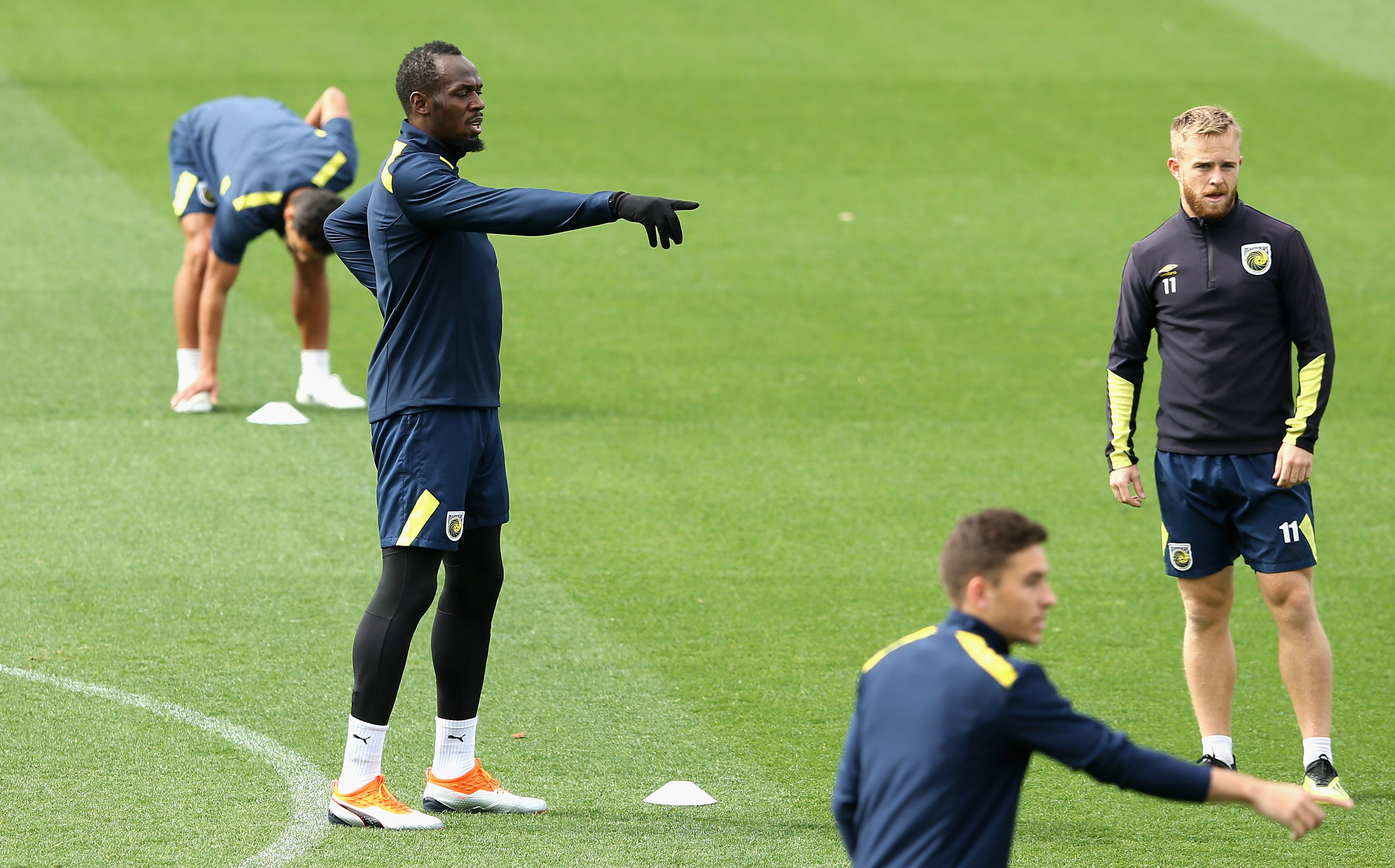 Usain Bolt and Connor Pain in Mariners training