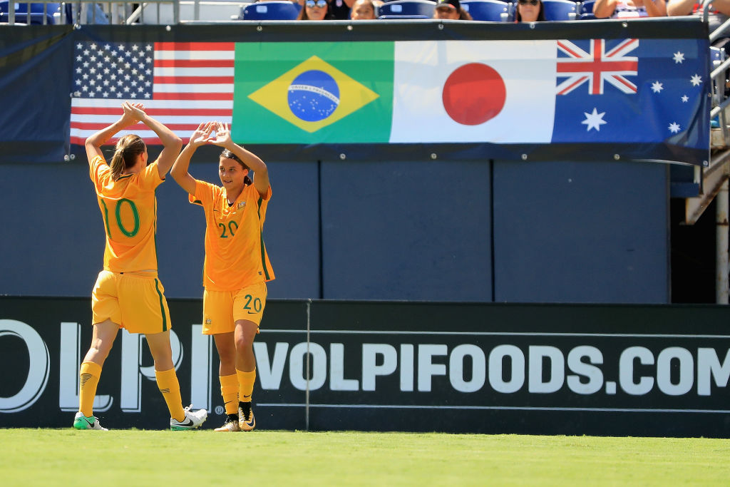 Emily van Egmond and Sam Kerr celebrate at the 2017 Tournament of Nations