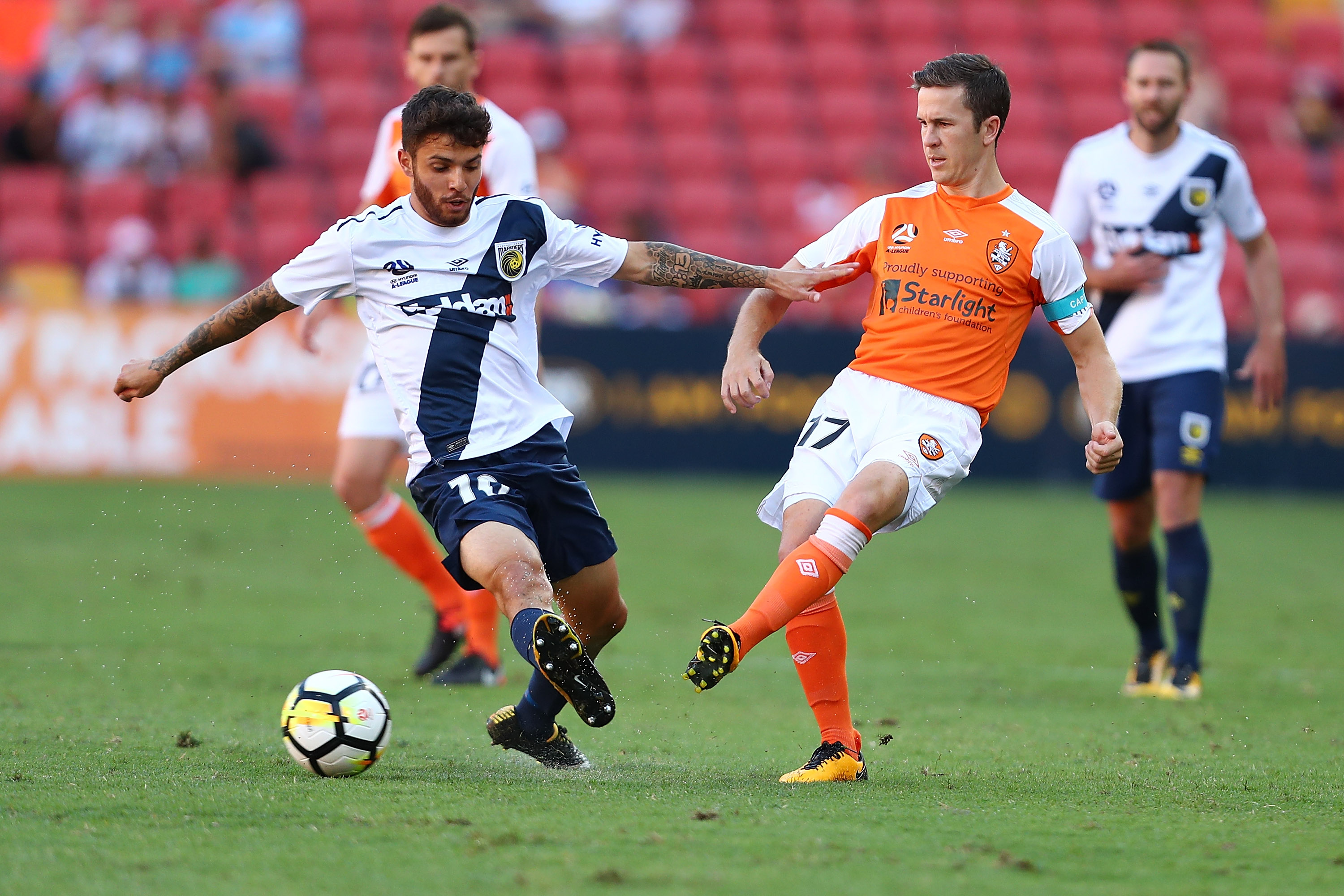 Matt McKay and Mariners' Danny De Silva on Sunday afternoon in Brisbane