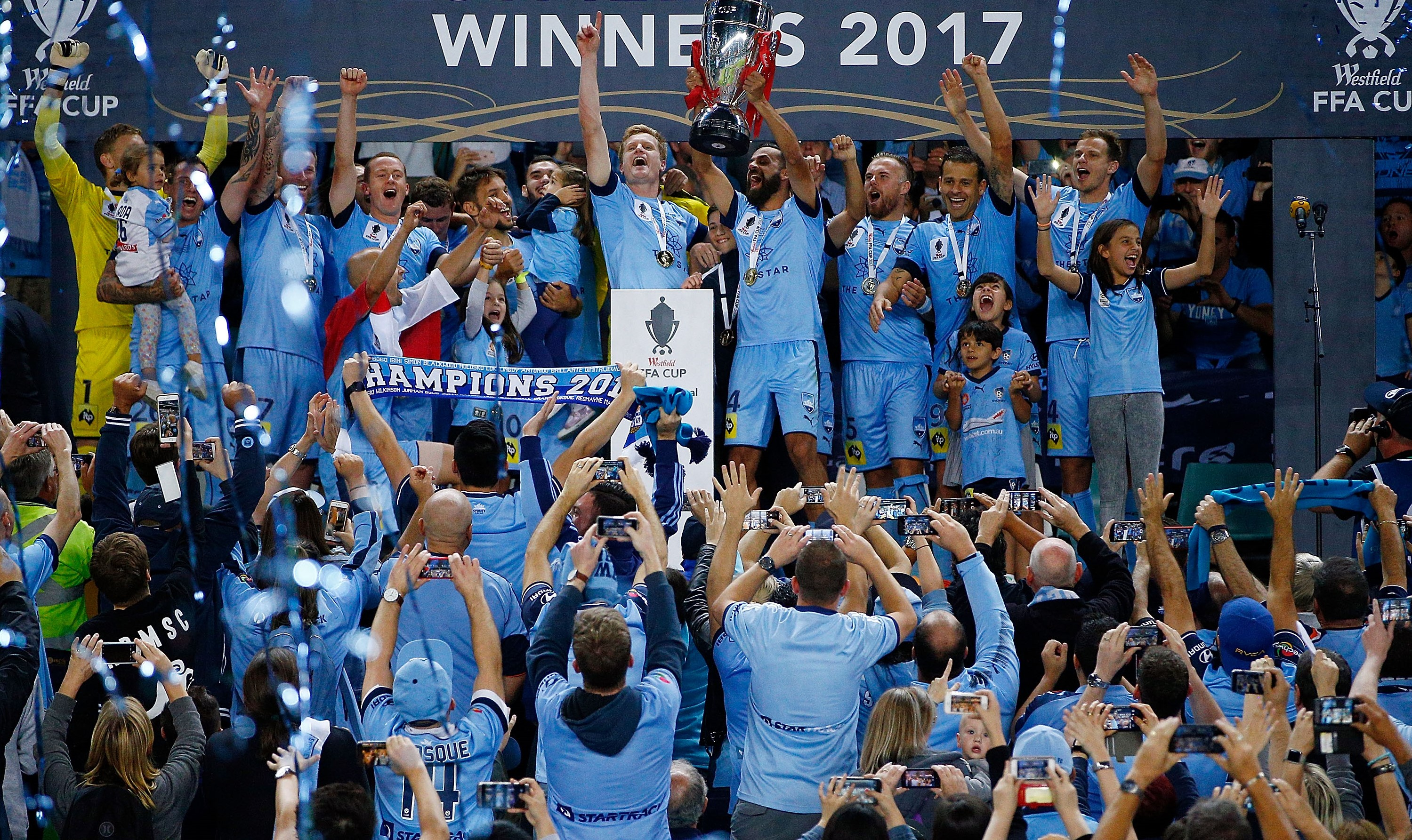 Sydney FC lifting the 2017 FFA Cup trophy