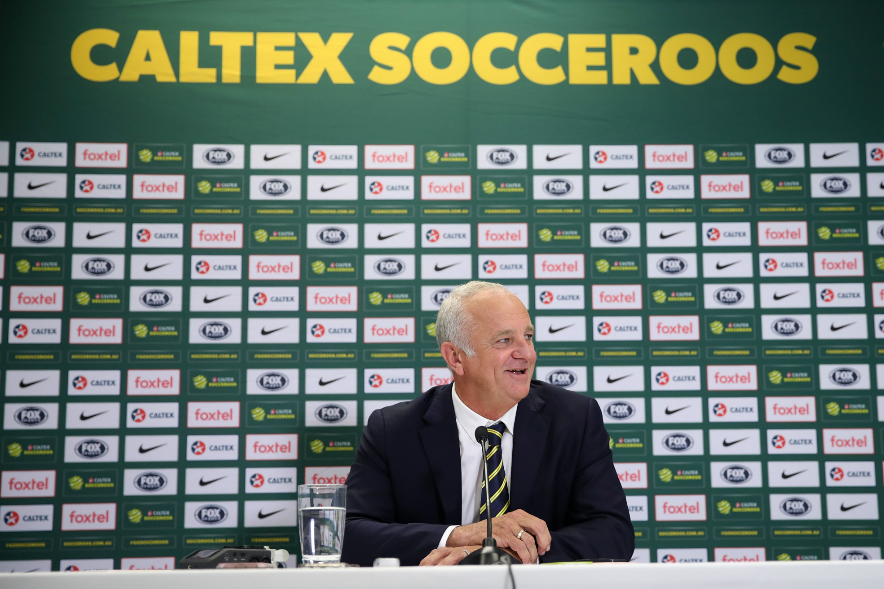 Graham Arnold sits in his press conference for the Caltex Socceroos