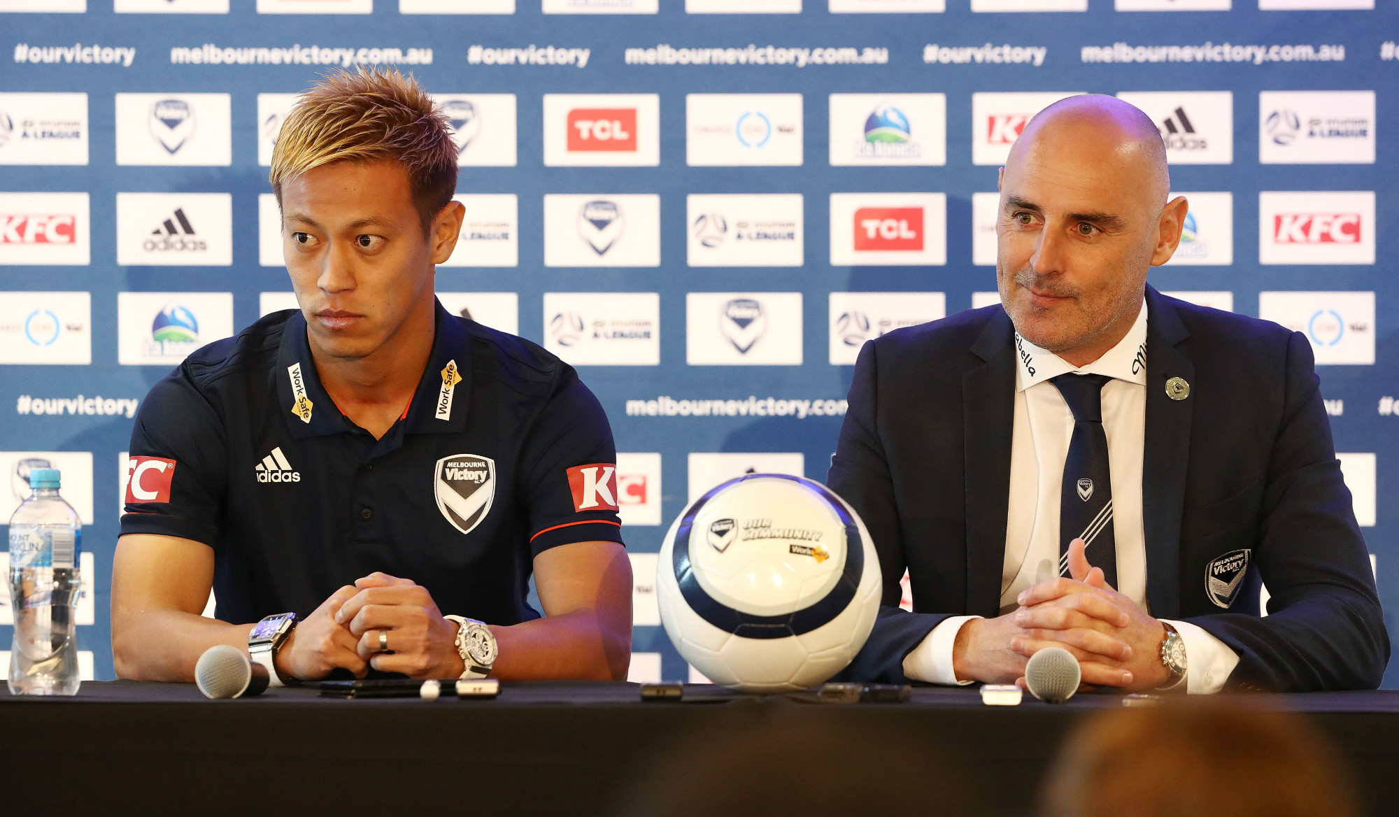 Honda and Muscat sit in the press conference