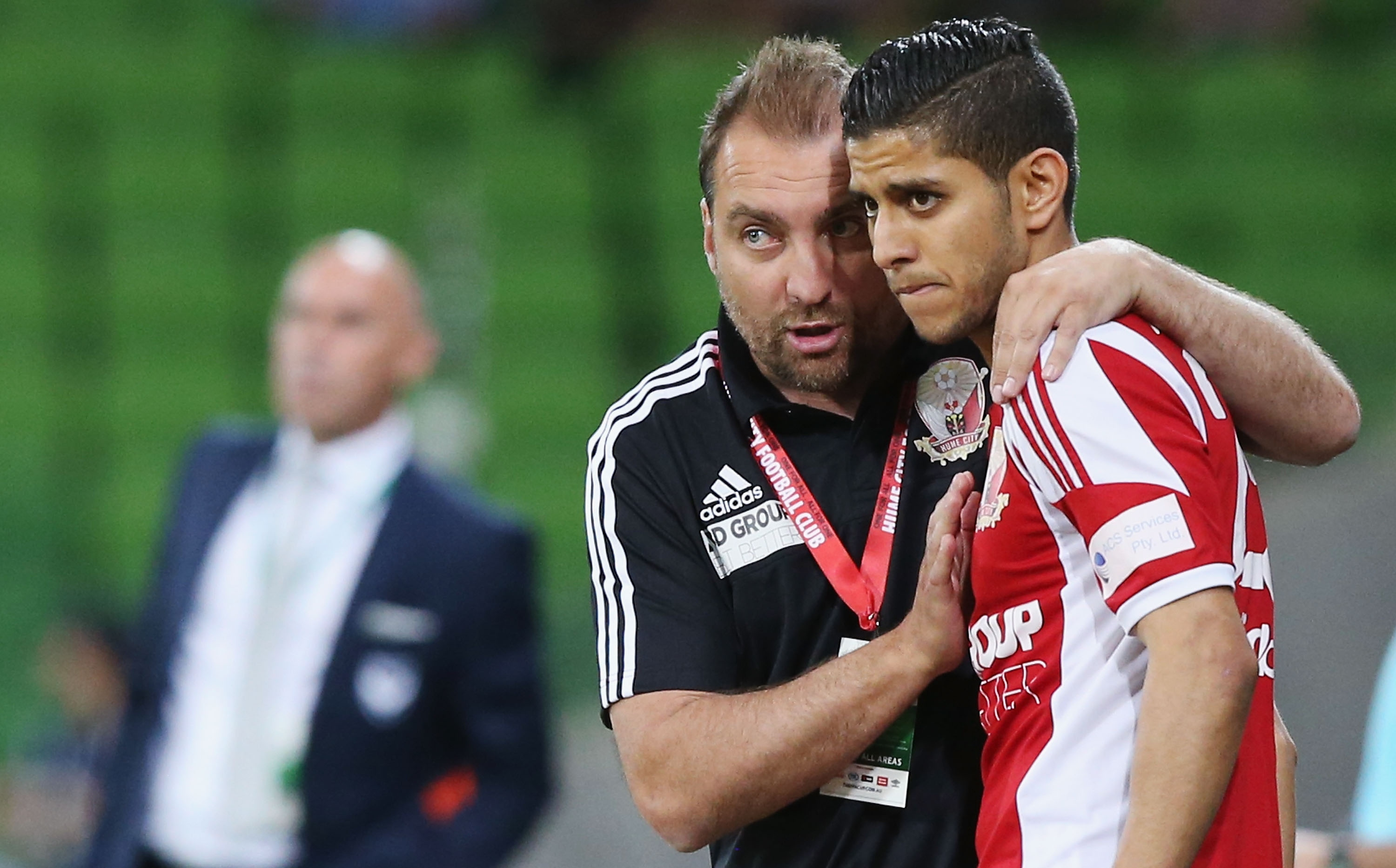 Lou Acevski gives instructions to Souheil Azagane during the FFA Cup Semi Final match between Hume City and Melbourne Victory at AAMI Park on October 28, 2015