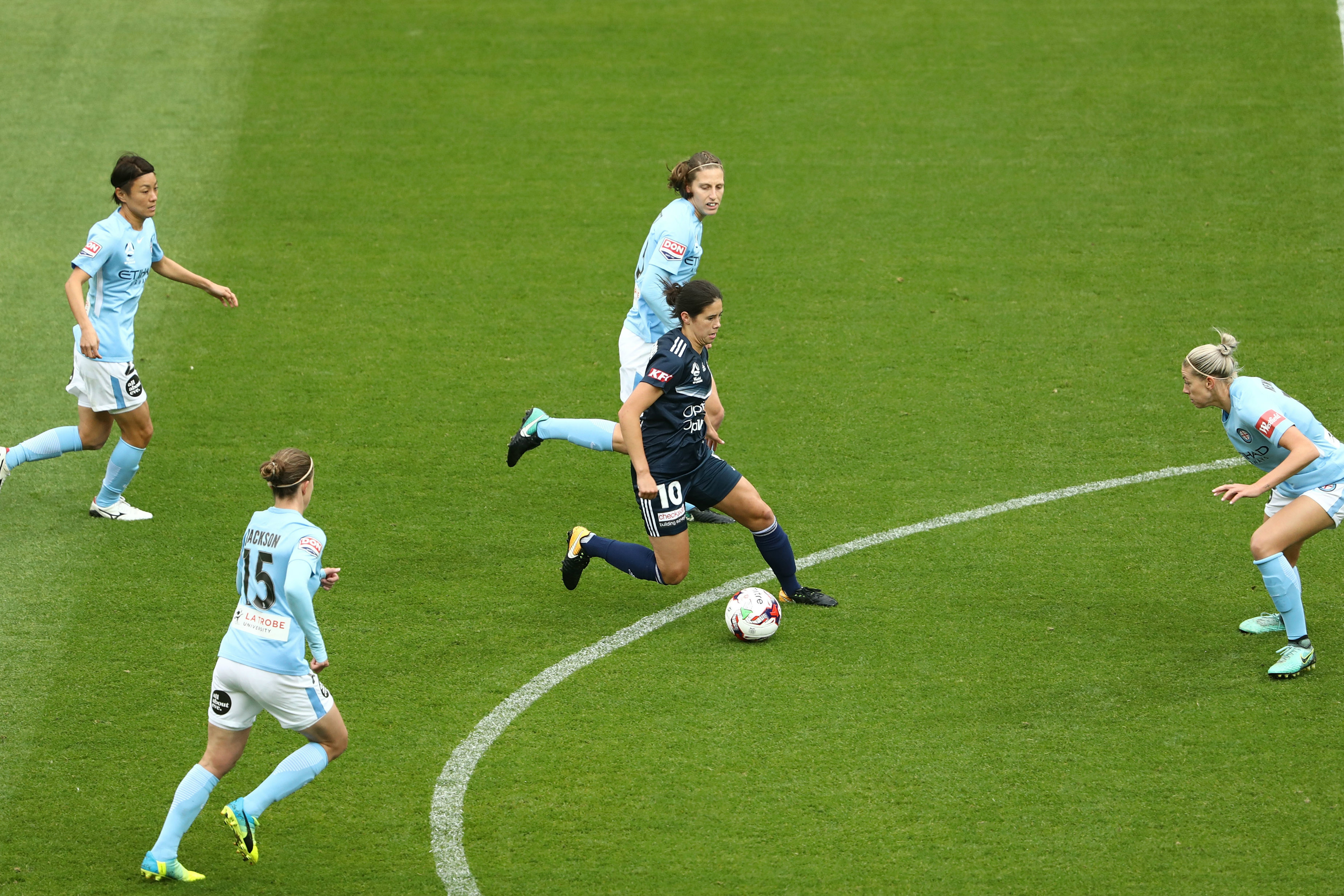Kyra Cooney-Cross surrounded by four Melbourne City players.