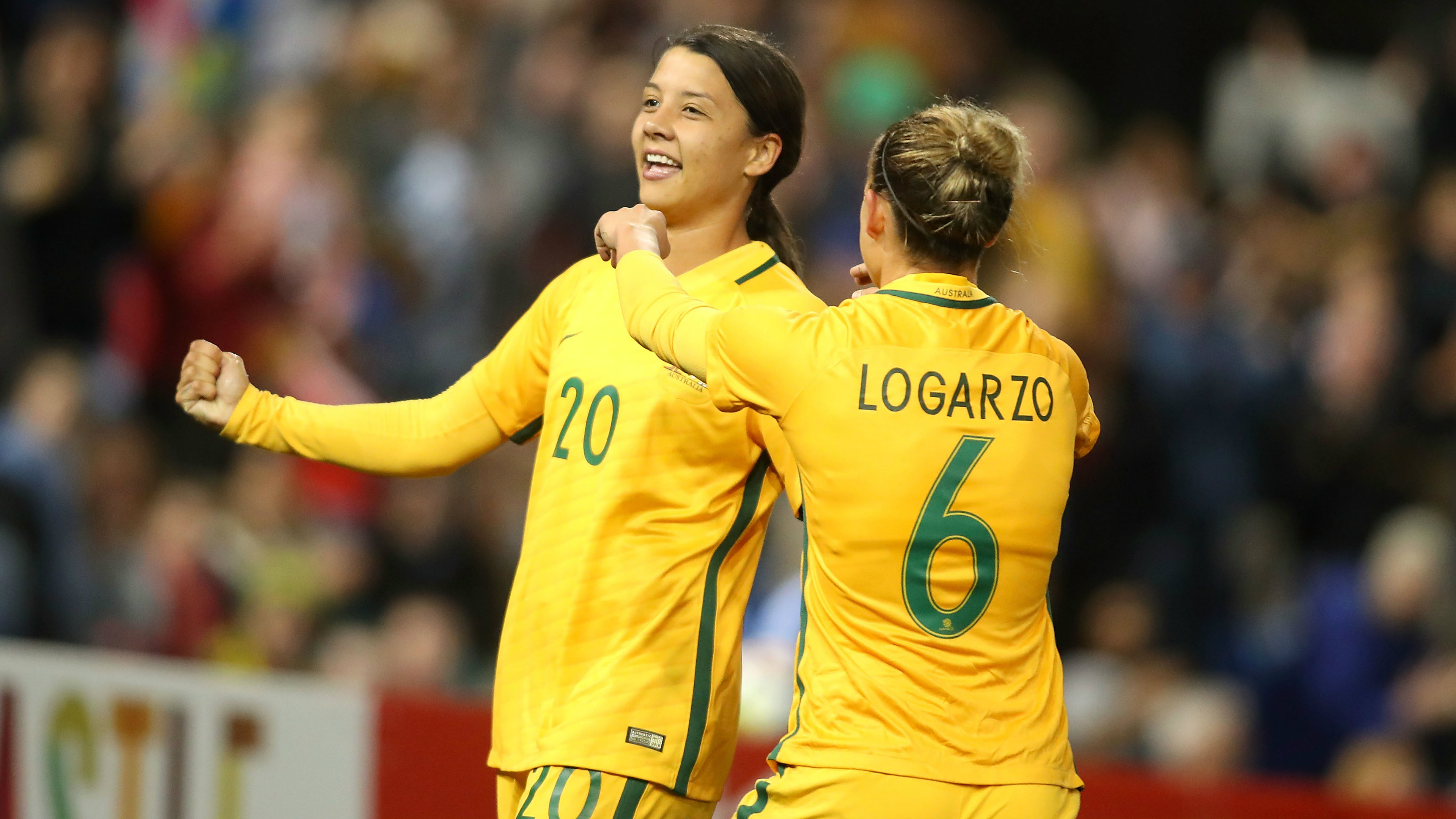 Sam Kerr and Chloe Logarzo celebrate a goal in the win over Brazil in Newcastle.