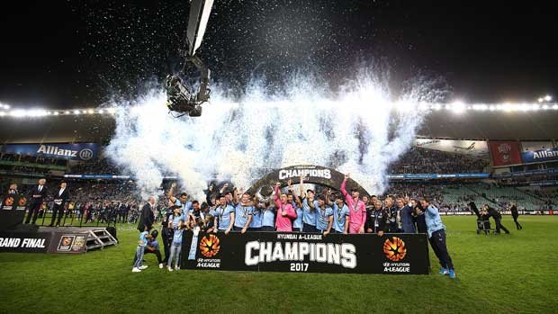 Sydney FC with the trophy