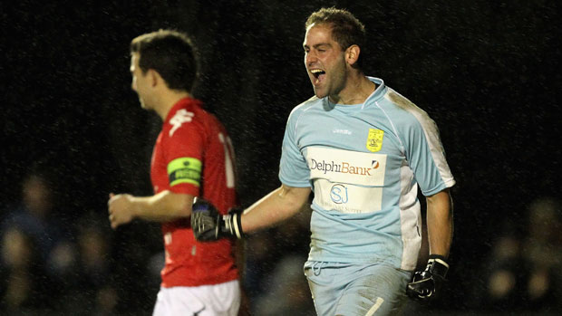 Rani Dowisha celebrates a save during the shootout against Cardiff.