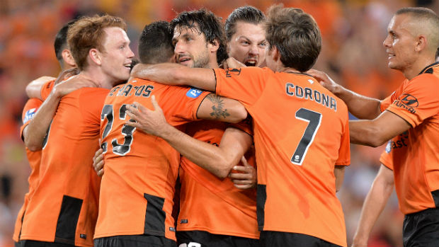Brisbane Roar players celebrate scoring at Suncorp Stadium.