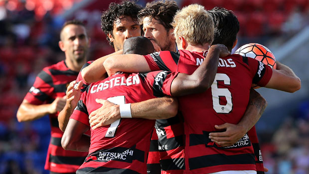 Wanderers players celebrate Jaushua Sotirio's first-half strike against the Jets.