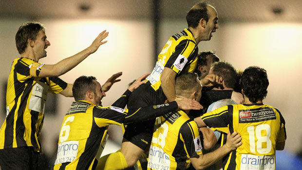 South Springvale players celebrate their penalty shootout win over Cardiff in the inaugural Westfield FFA Cup.