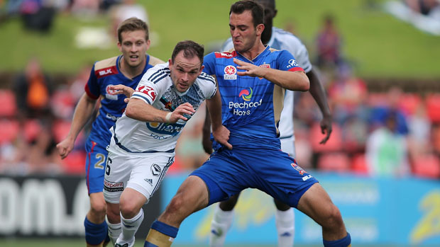 Ben Kantarovski fights for the ball with Victory midfielder Leigh Broxham.