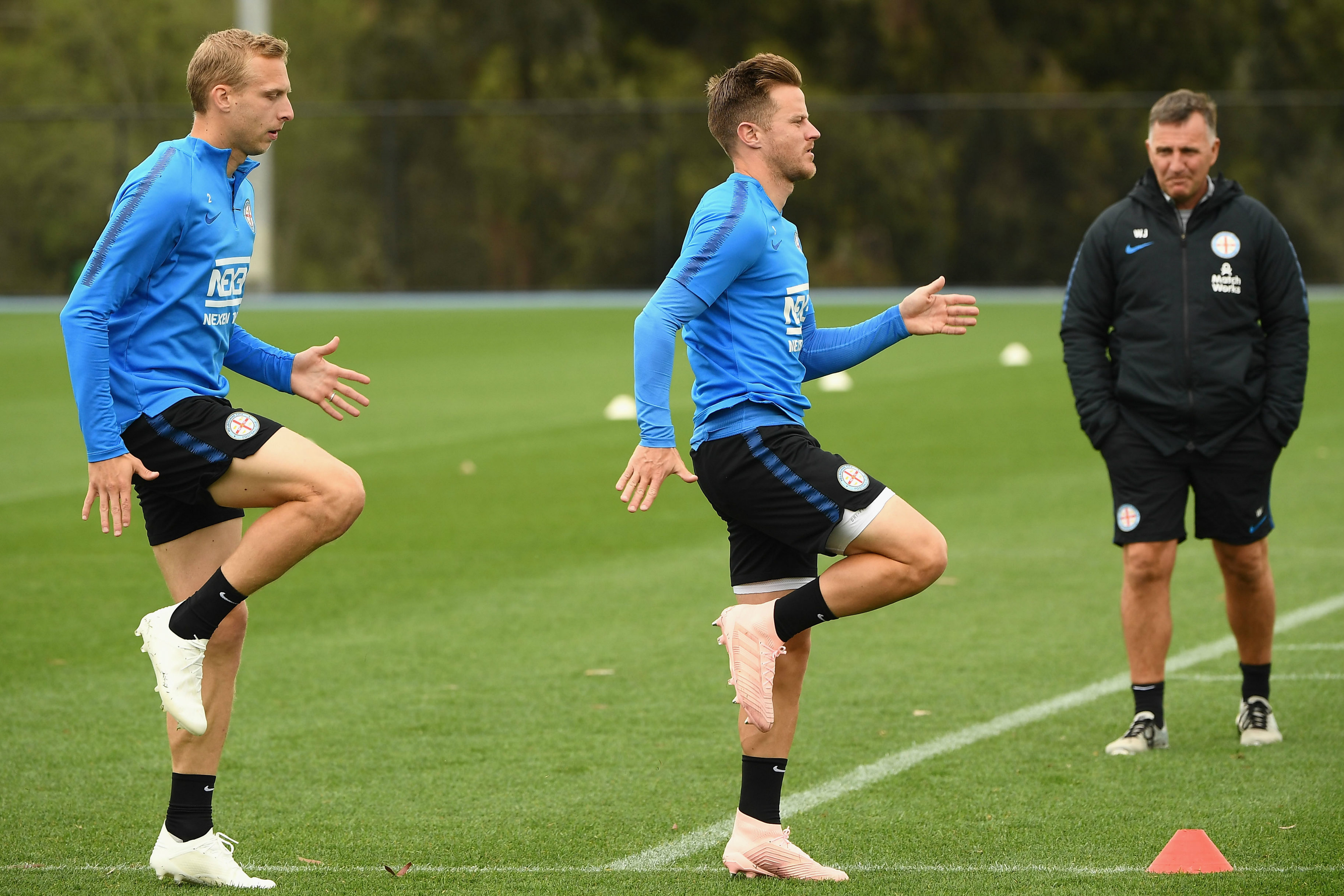 Ritchie De Laet and Scott Jamieson in training as Warren Joyce watches on.