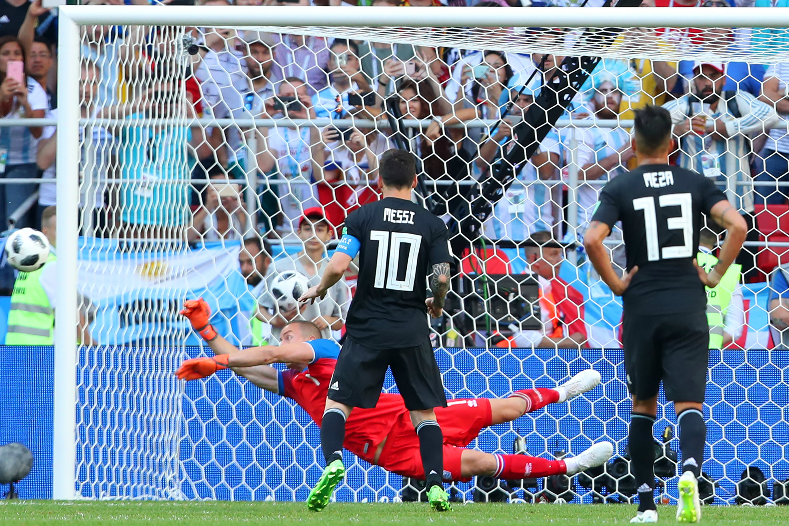 Iceland keeper Hannes Thor Halldorsson denies Lionel Messi's penalty.