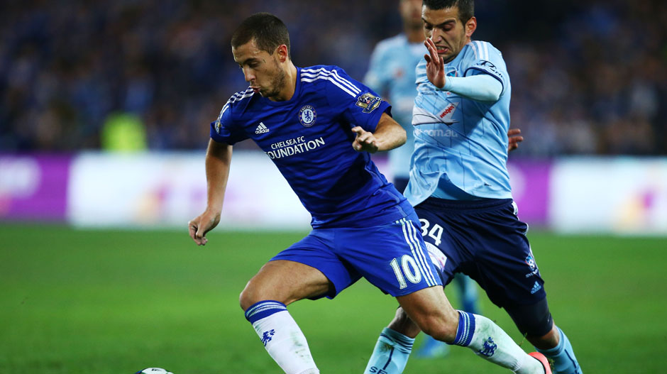 Eden Hazard dribbles the ball past Robert Stambolziev.