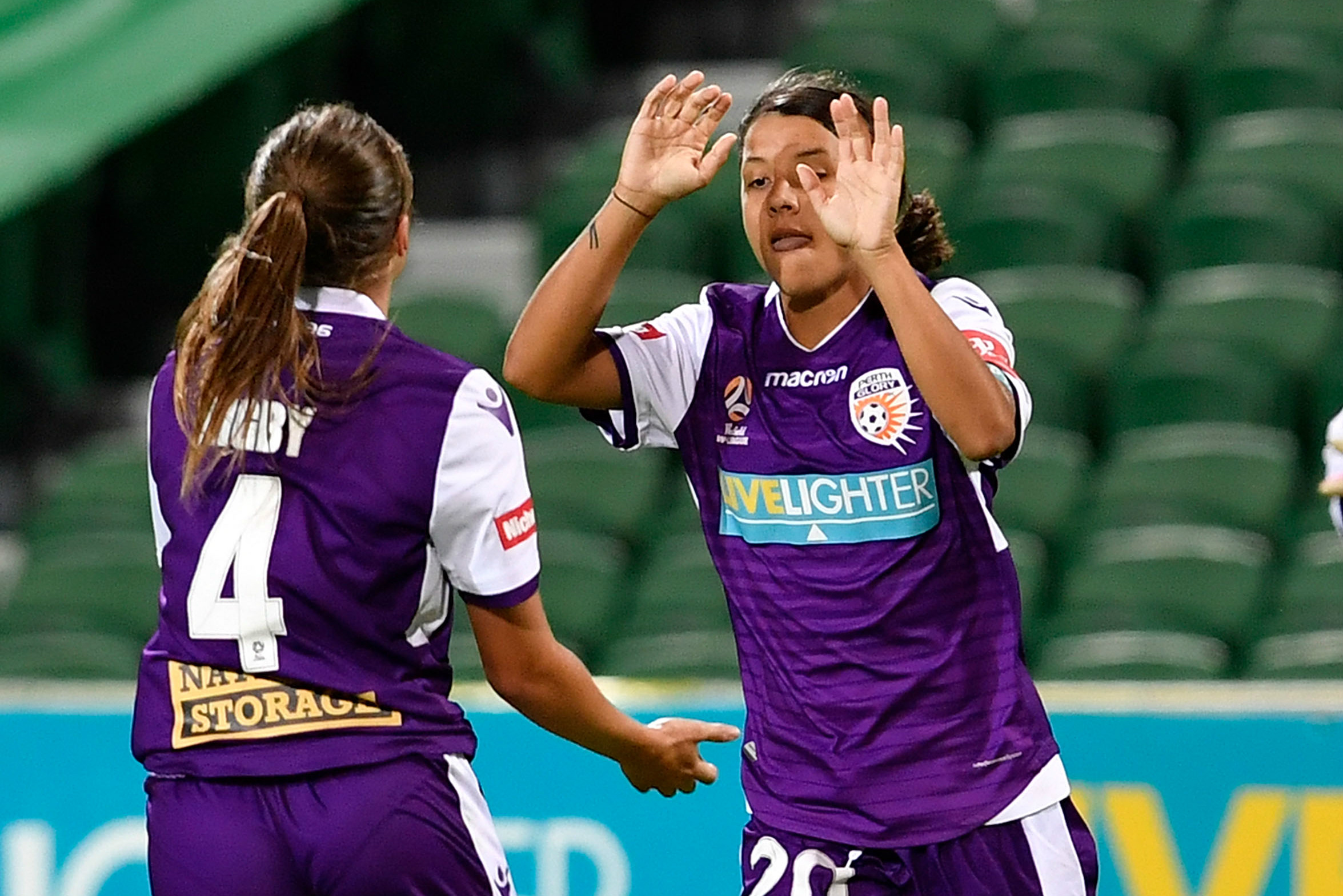 Sam Kerr celebrates one of her two goals against the Wanderers.