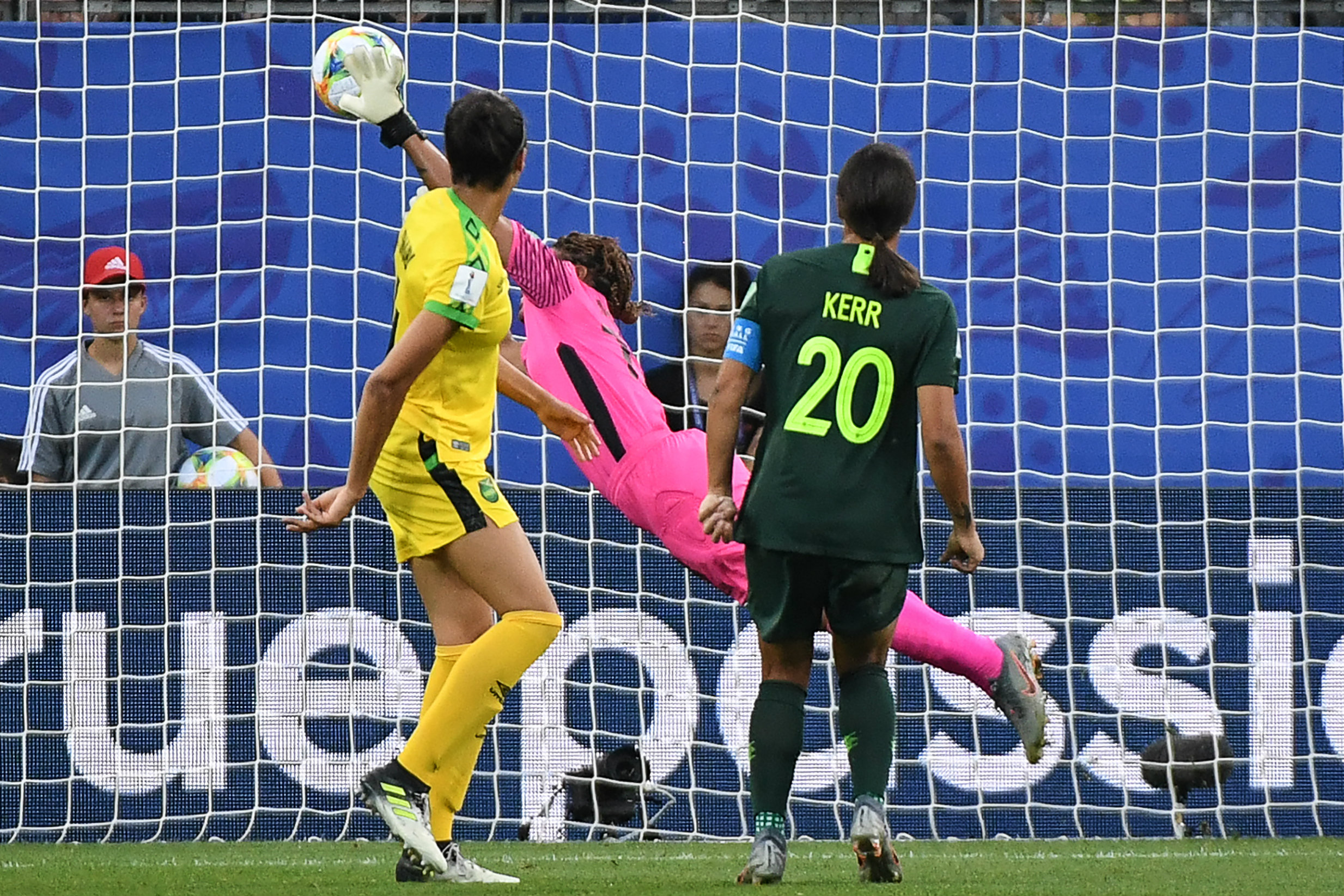 Sam Kerr watches on as her first header beats the Jamaican keeper