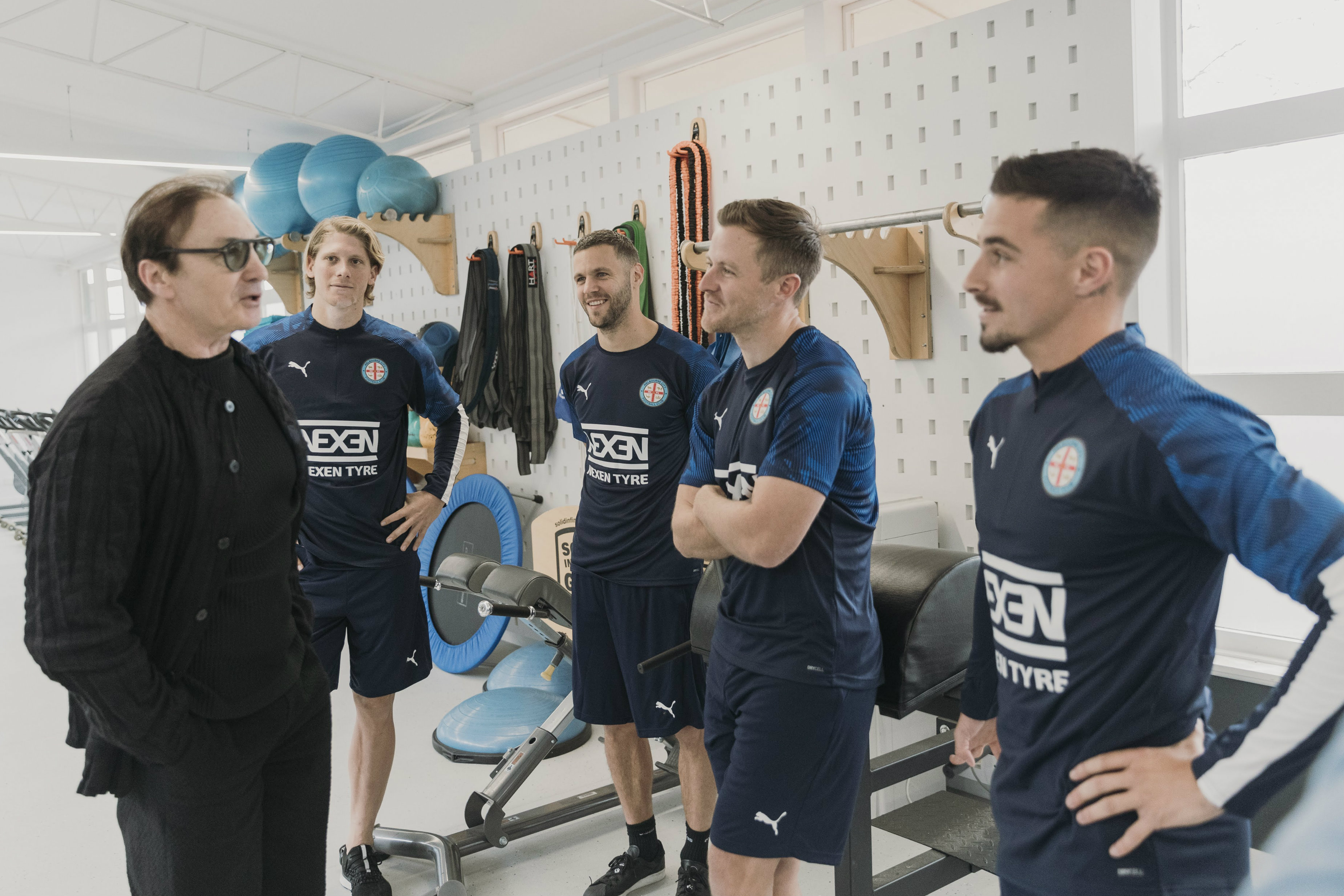 Erick Mombaerts meets some of the Melbourne City squad on Monday