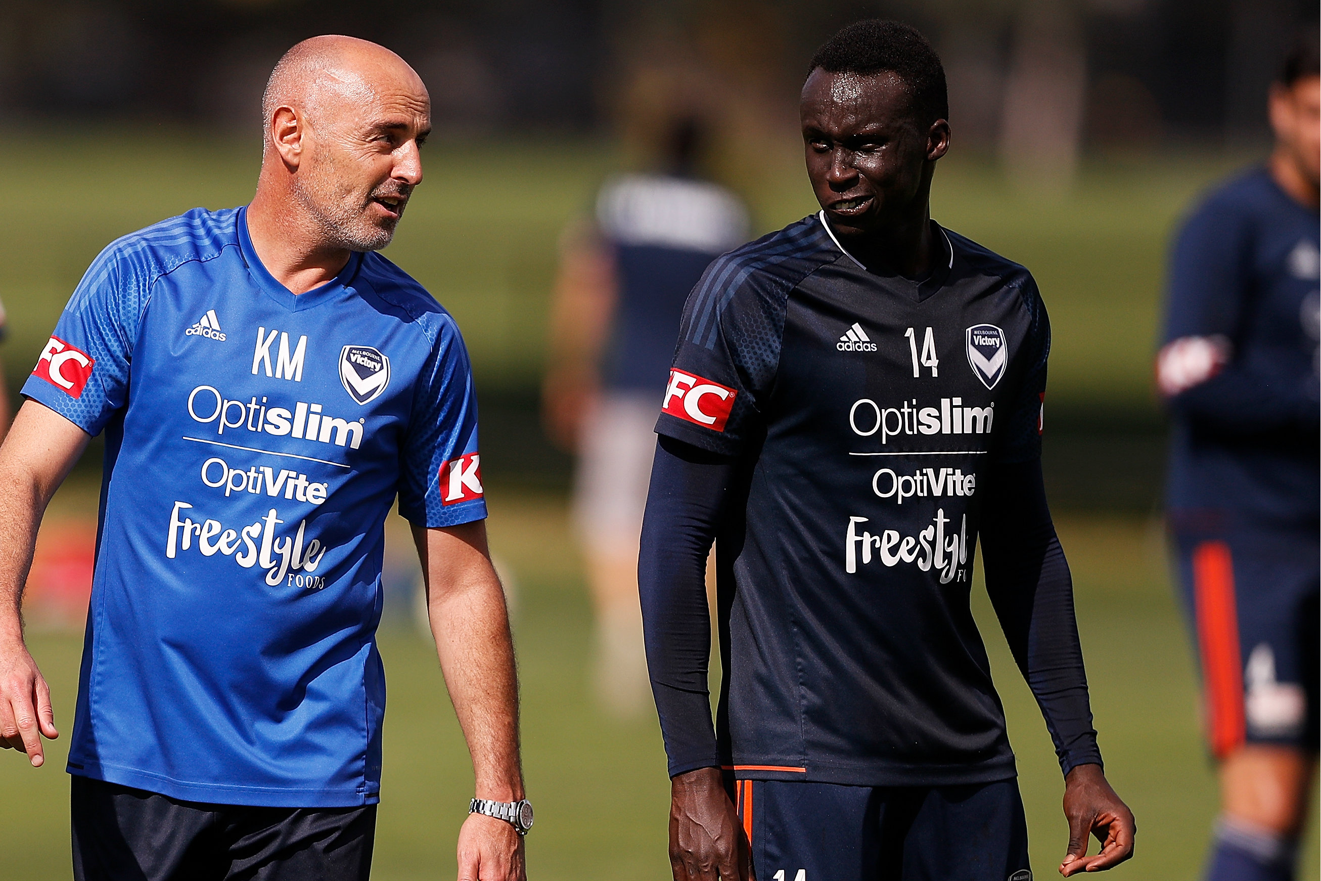 Thomas Deng receives some instructions from Victory boss Kevin Muscat.