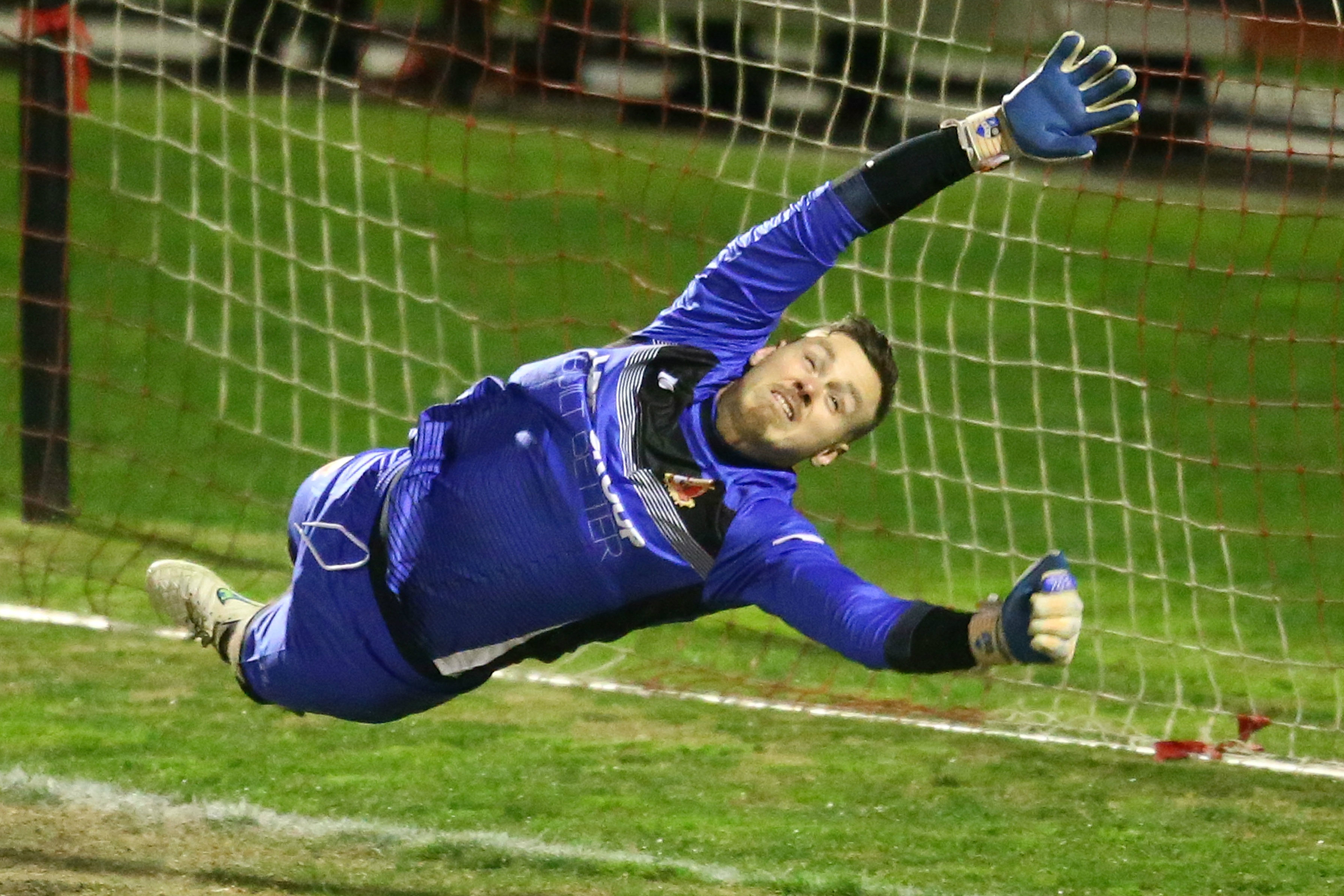 Chris Oldfield makes a save for Hume City in the FFA Cup.