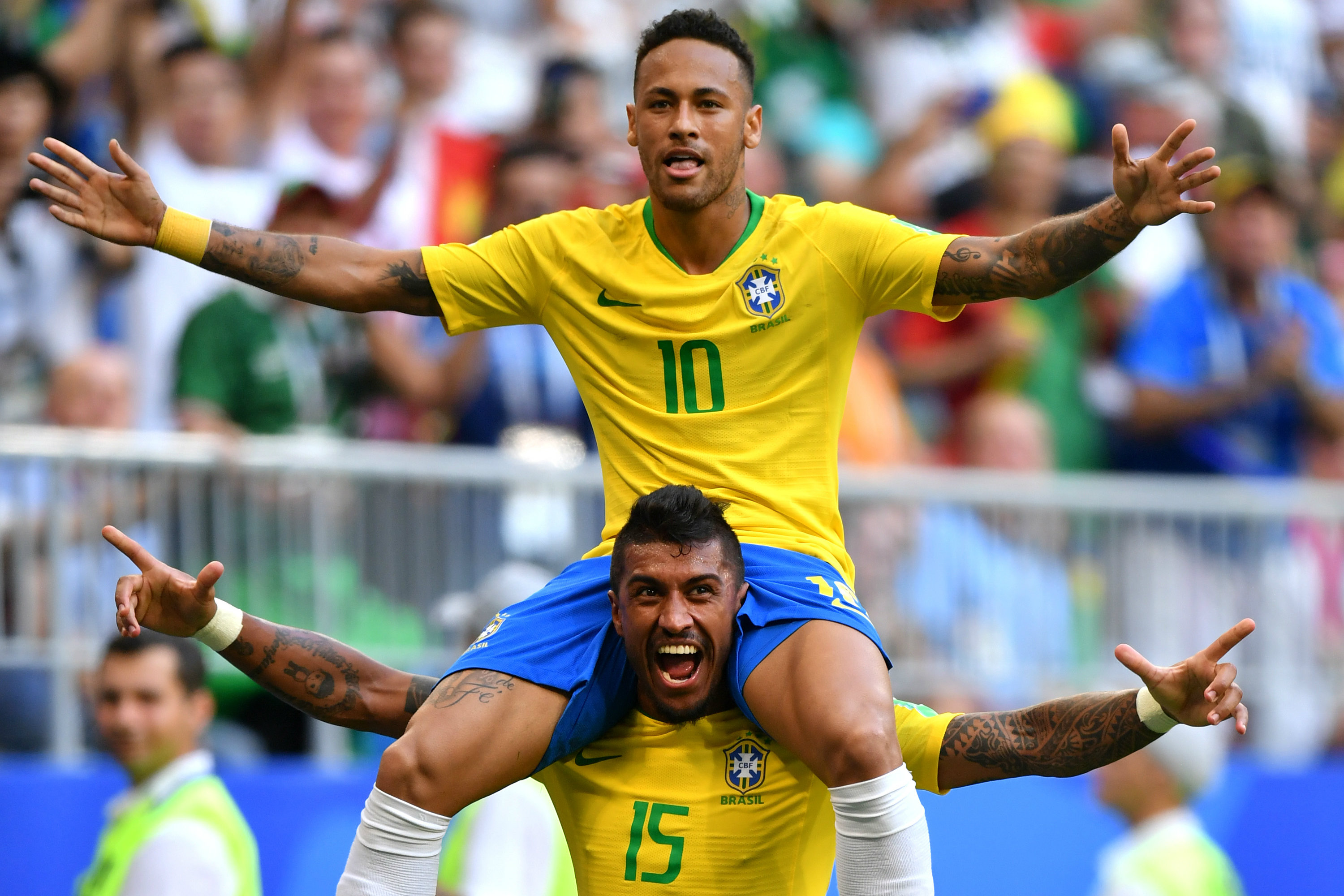 Paulinho and Neymar celebrate a goal for Brazil at the World Cup in Russia.