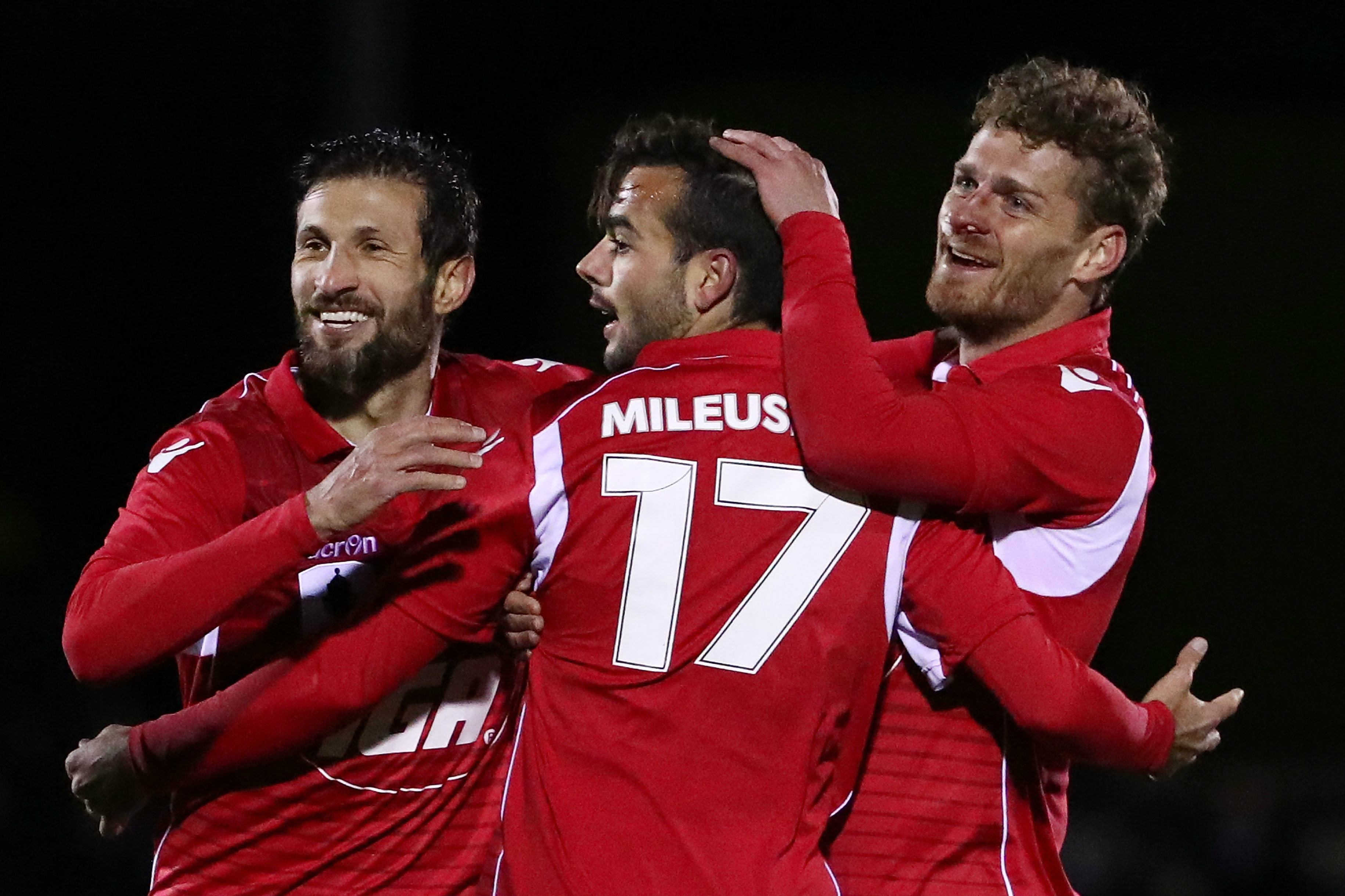 Adelaide United players celebrate a goal during the Westfield FFA Cup.