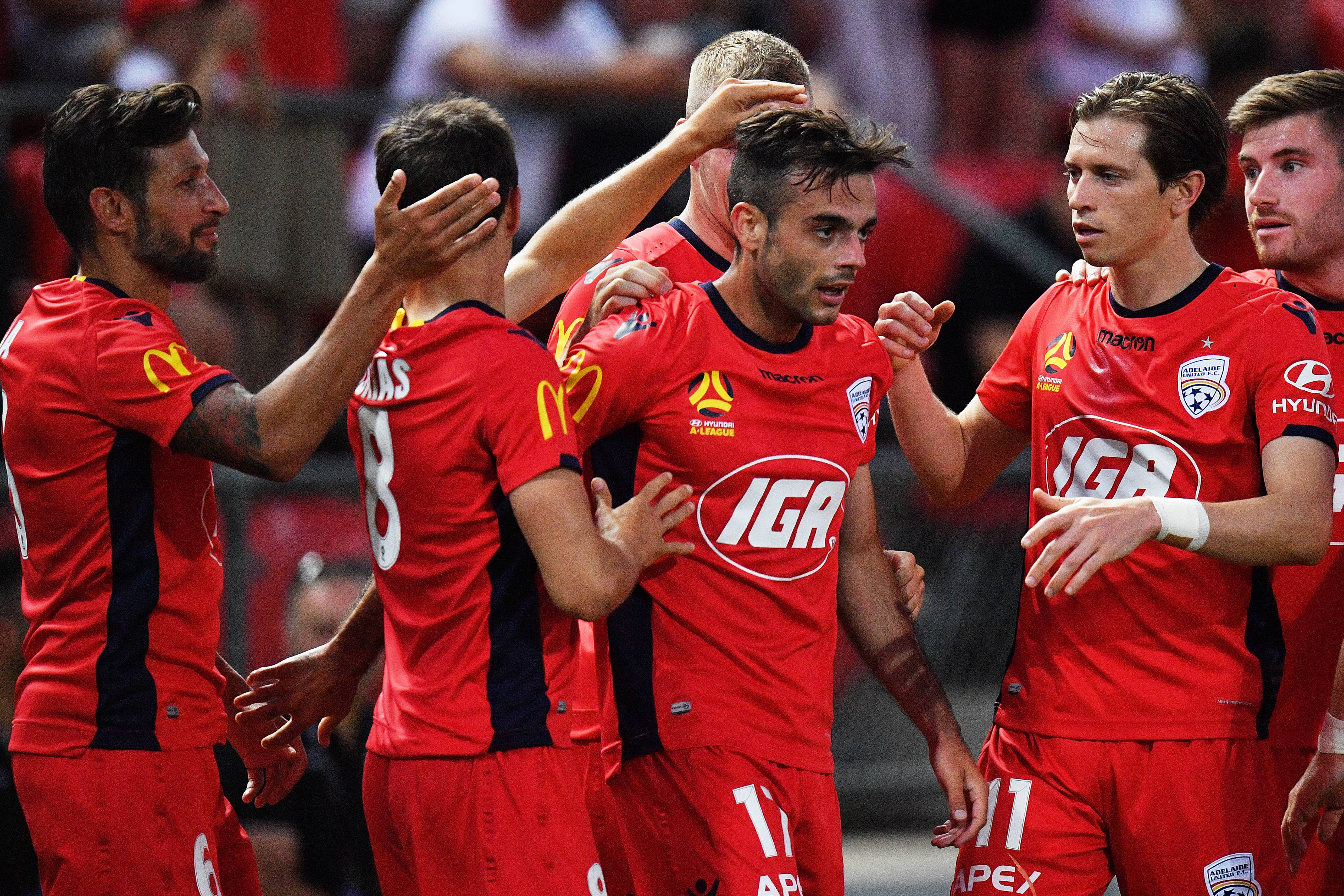 Adelaide United celebrate a goal