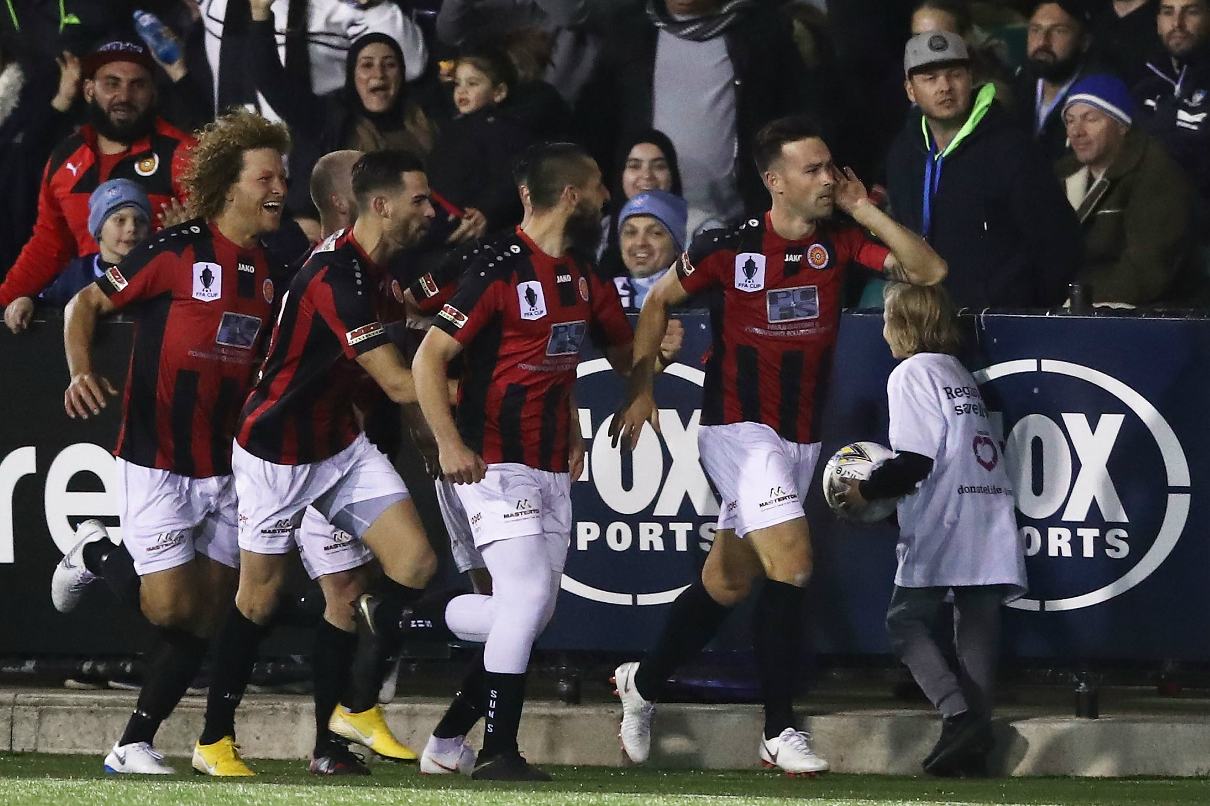 Rockdale City celebrate Gaitatzis' early goal.