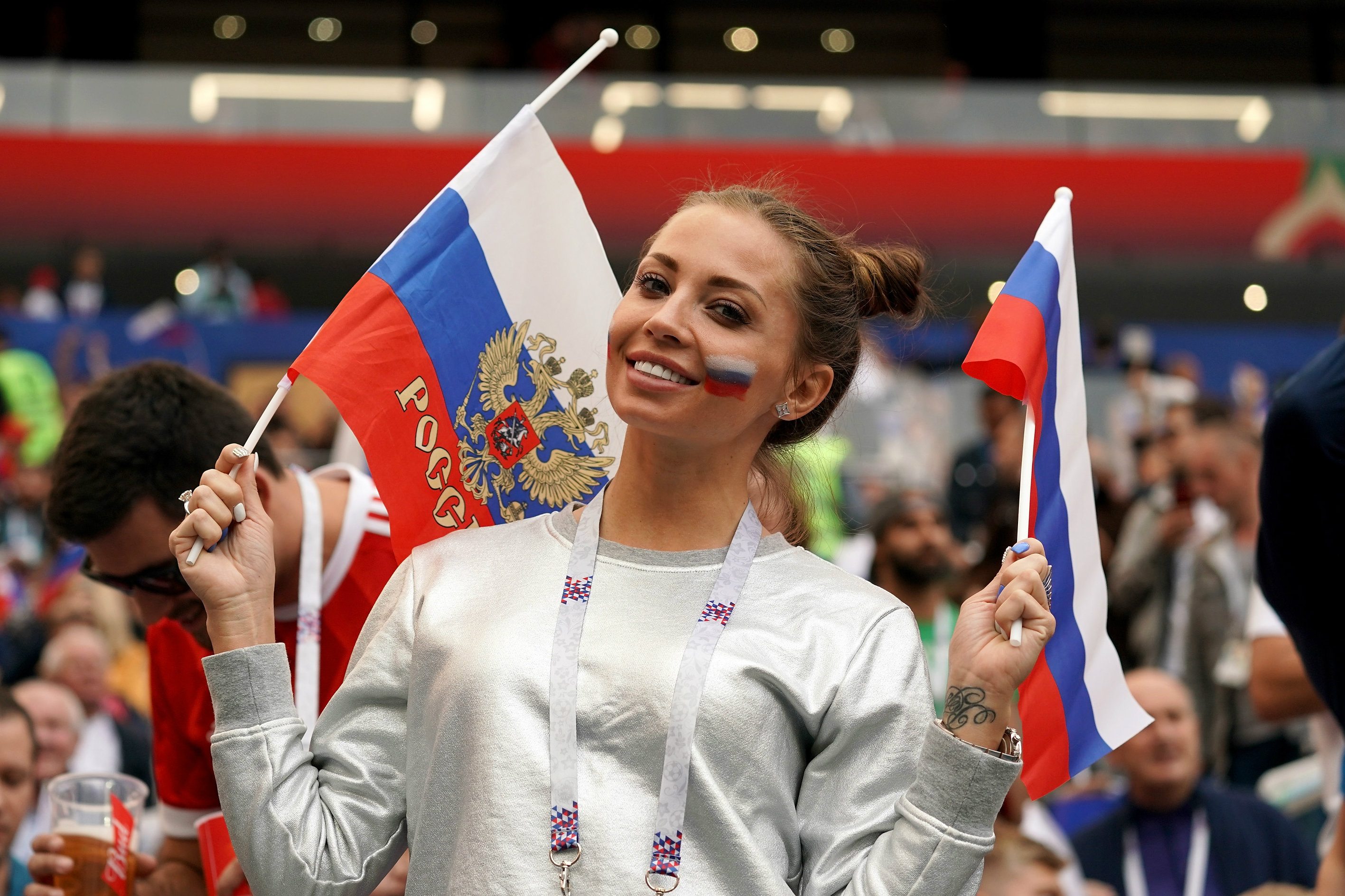 A Russian fan enjoys her team's big win over Saudi Arabia.
