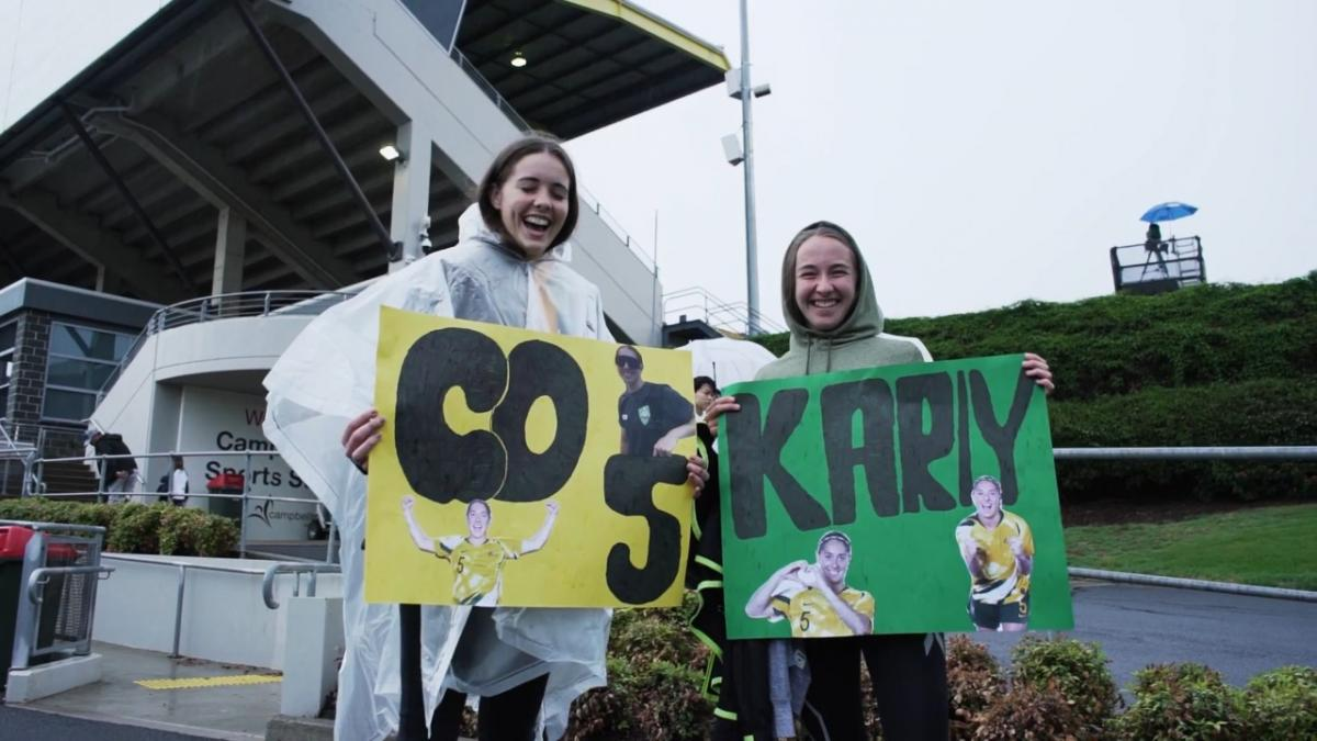 We'd do anything for them: Westfield Matildas fans brave the rain in Campbelltown