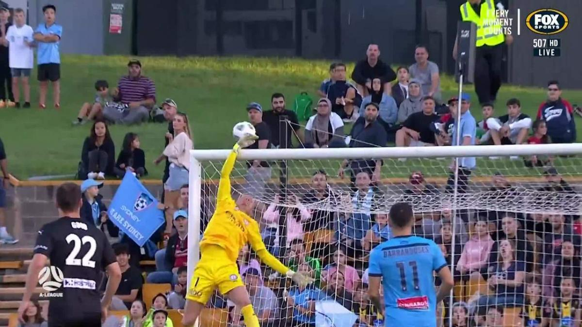 SAVE: Glover  -Brattan almost catches out the shot-stopper