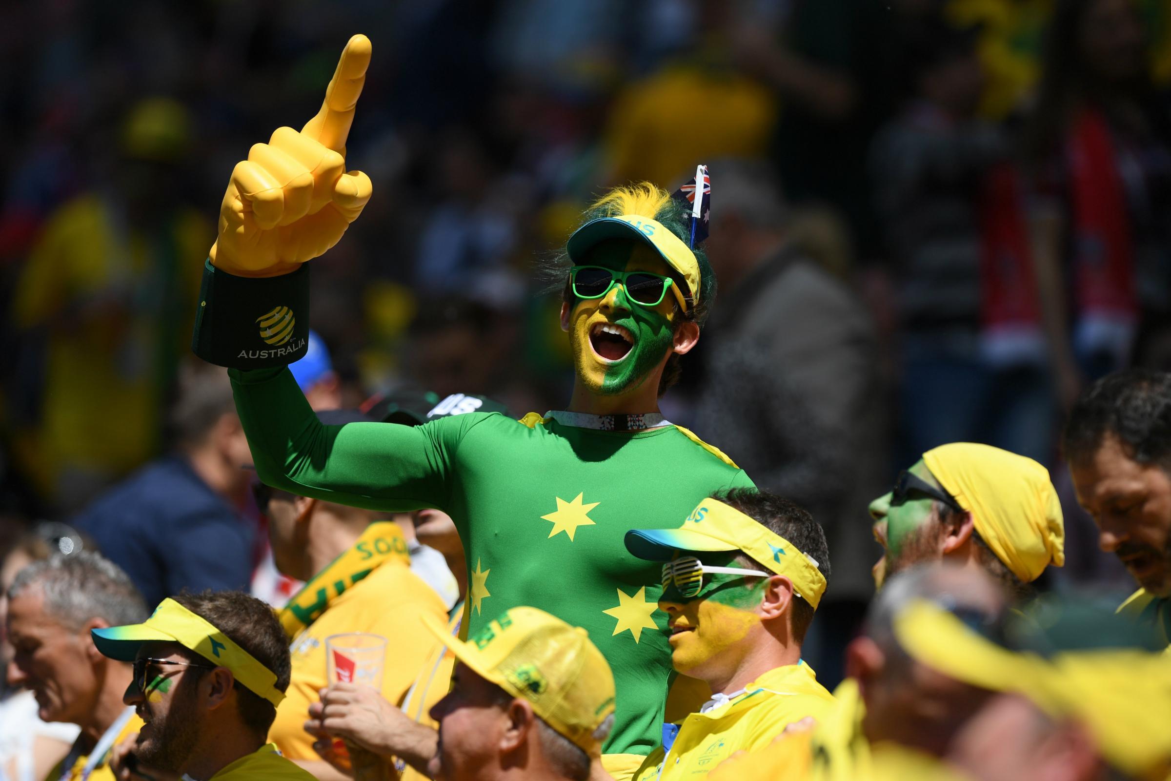 A Socceroos fan in full voice in Kazan.