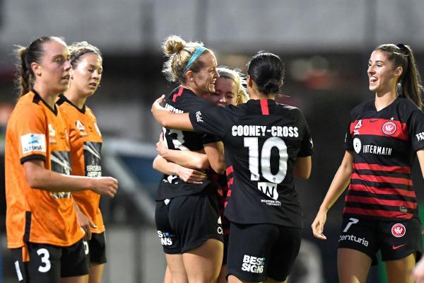 Kristen Hamilton celebrates a goal for Wanderers