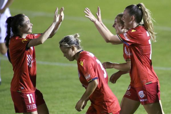 Adelaide United celebrate a goal