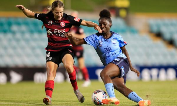 Wanderers' Courtney Nevin and Sydney FC's Princess Ibini tussle in the Sydney Derby.
