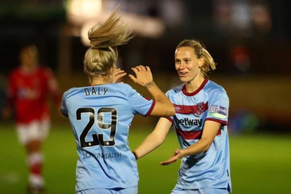 Emily van Egmond celebrates with Rachel Daly