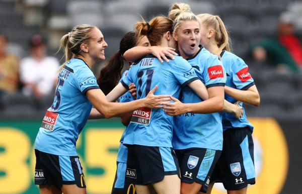 Sydney FC celebrate a goal against Wanderers