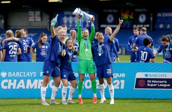 Sam Kerr celebrates Chelsea's title with team mates