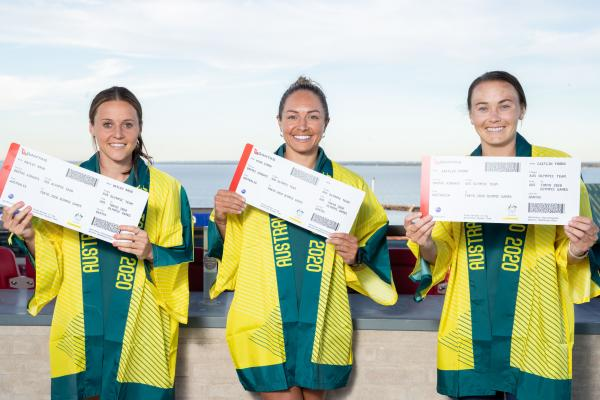 Hayley Raso, Kyah Simon and Caitlin Foord with their Tokyo 2020 Olympic Qantas boarding passes