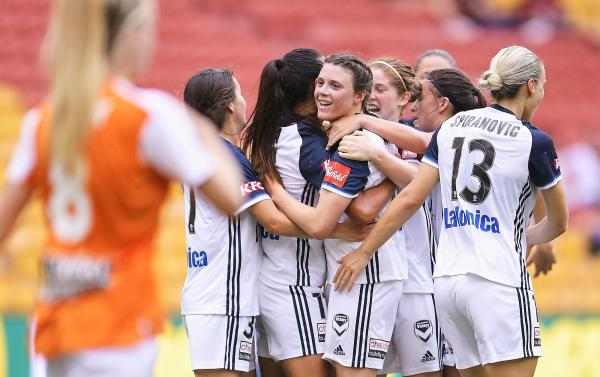 Ayres celebrates a goal against Brisbane