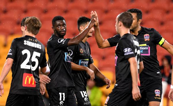 Kwabena Appiah-Kubi celebrates with Newcastle Jets team-mates