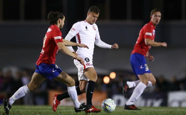 Oriol Riera runs at Bonnyrigg Whites Eagles defenders