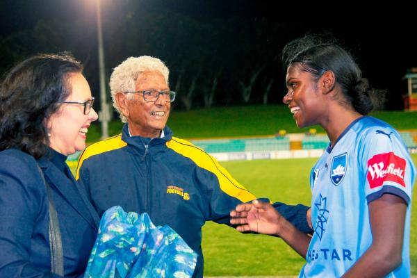 Evans greets her mentor John Moriarty, the first recognised Indigenous Australian to be selected for the national football team