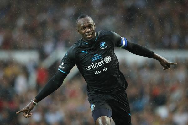 Bolt scores in a charity match at Old Trafford