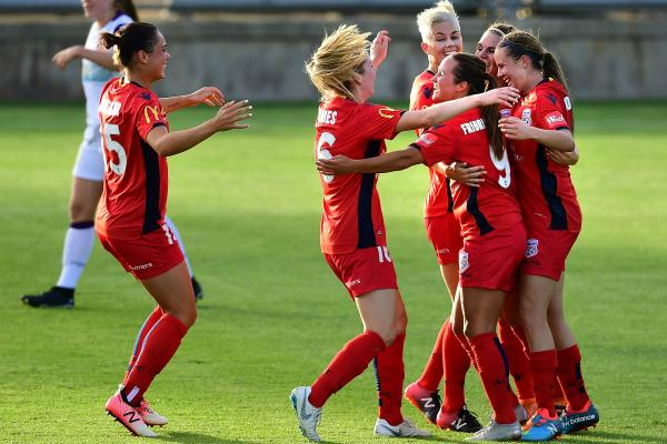 Adelaide United celebrate a goal.
